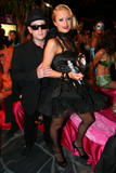 Paris Hilton in black dress showign her legs in black fishnet stockings at Paris Hilton's My New BFF Masquerade Ball at Kress in Hollywood